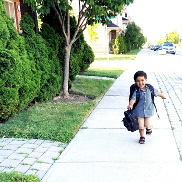 child running home from school.
